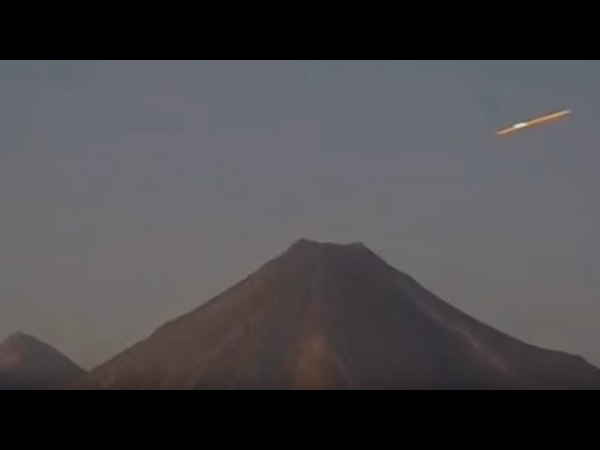 ORB UFO FLIES INTO FRAME AND SITS NEXT TO THE COLIMA VOLCANO AND THEN EXITS