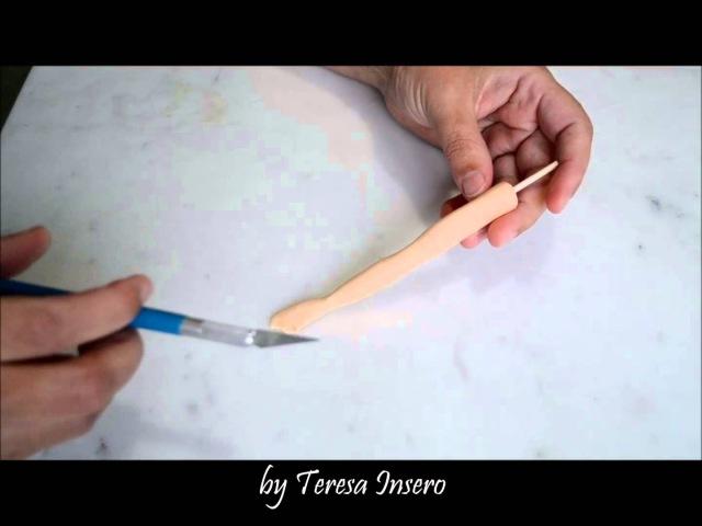 Braccio e mano in pasta di zucchero